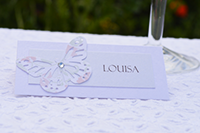 Image of Broderie Antique Rose place card with butterfly and gem.