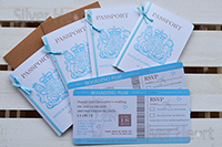 two passport invitations with kraft envelope