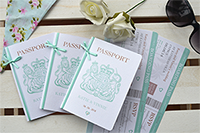 3 passport invitations showing lion and crown emblem on front and two types of bow decoration.
