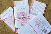 three passport invitations, one showing the invitation insert and two boarding pass style RSVPs