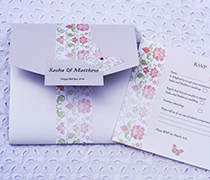 Antique Broderie invitation with bow