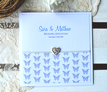 Butterfly Damask invitation with diamante heart, butterlfy design and linen card