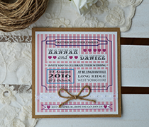 Candy stripe vintage invitation with vintage design, stripes, phrases in various fonts on kraft card and lace with twine bow.