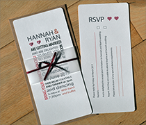 contemporary hannah invitation with font design, vellum belly band and satin ribbon and bow.