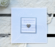 Louisa invitaton with sparkle card panel, sheer silver ribbon and diamante heart