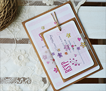 Pretty Polka dot invitation bundle with vellum belly band, seed pearls, RSVP and twine loop.