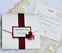 ribbons and Bows pocketfold invitation with satin ribbon, vellum and card panel with diamante and organza bow, with up to four inserts.