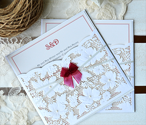 Photo of Butterfly and Lace laser cut invitation for link below to laser cut invite page.
