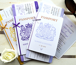 Passport invitations and boarding pass style RSVPs, one invite open showing the photograph and information inserts.