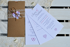 Champagne and Roses cheque book wedding invitation, on broderie, lace effect card with a satin dior bow, diamante buckle and gems.