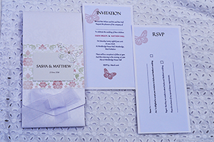Ribbons and Bows cheque book wedding invitation, with satin dior ribbon, vellum and pearlescent panels and an organza bow.