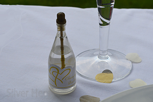 Image of gold top wedding champagne bubbles for wedding tables.