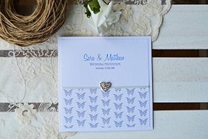 Butterfly Damask wedding stationery designs, on linen card decorated with a linen panel printed with damask pattern and a diamante heart embellishment.