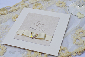 Champagne and Bows thank you  card.  Elegant pearlescent gatefold card with broderie  textured lace effect panel, embellished with double faced satin ribbon dior bow, diamante buckle.