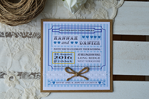 Candy Stripe Vintage flat invitation. Vintage style kraft card with panels of pearlescent or linen card with arts and crafts poster style design with blue candy stripes, lace ribbon, twine bows, and pearls.