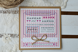 Candy Stripe Vintage flat invitation. Vintage style kraft card with panels of pearlescent or linen card with arts and crafts poster style design with pink candy stripes, lace ribbon, twine bows, and pearls.