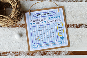Example of save the date, double mounted card with loop to hang up.