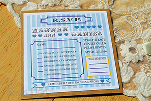Candy Stripe Vintage flat RSVP. Vintage style kraft card with panels of pearlescent or linen card with arts and crafts poster style design with blue candy stripes.