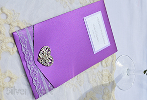 Passionate Purple pocketfold invitation, decorated with lace and large heart diamante embellishment.