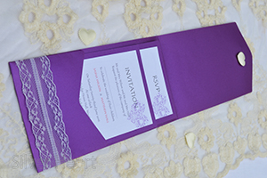 Passionate Purple pocketfold invitation, decorated with lace and large heart diamante embellishment. Open showing two inserts: RSVP and Invitation.