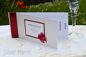 Ribbons and Bows cheque book invitation (open showing RSVP and Invitation insert).