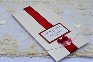 Picture of Ribbons and Bows long pocketfold invitation, decorated with satin ribbon, organza bow and gem.