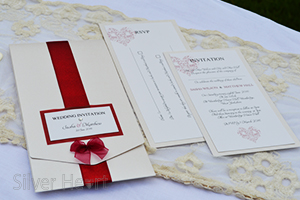 Ribbons and Bows long pocketfold invitation showing RSVP and invitation inserts.