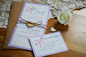 Sparkles and Hearts wedding stationery design. A flat double mounted invitation created using pearlescent card and sparkle card, bound togther with delicate lace trim, a cute wooden heart and a hemp twine bow