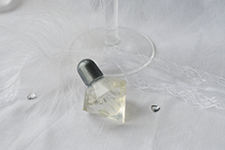Image of a single bottle of crystal shaped bubbles with silver top for wedding tables.