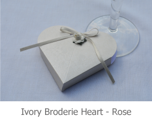 Ivory Broderie Heart favour with rose, image.